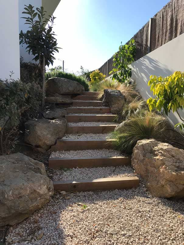 Wide staircase made with large stones and sleepers